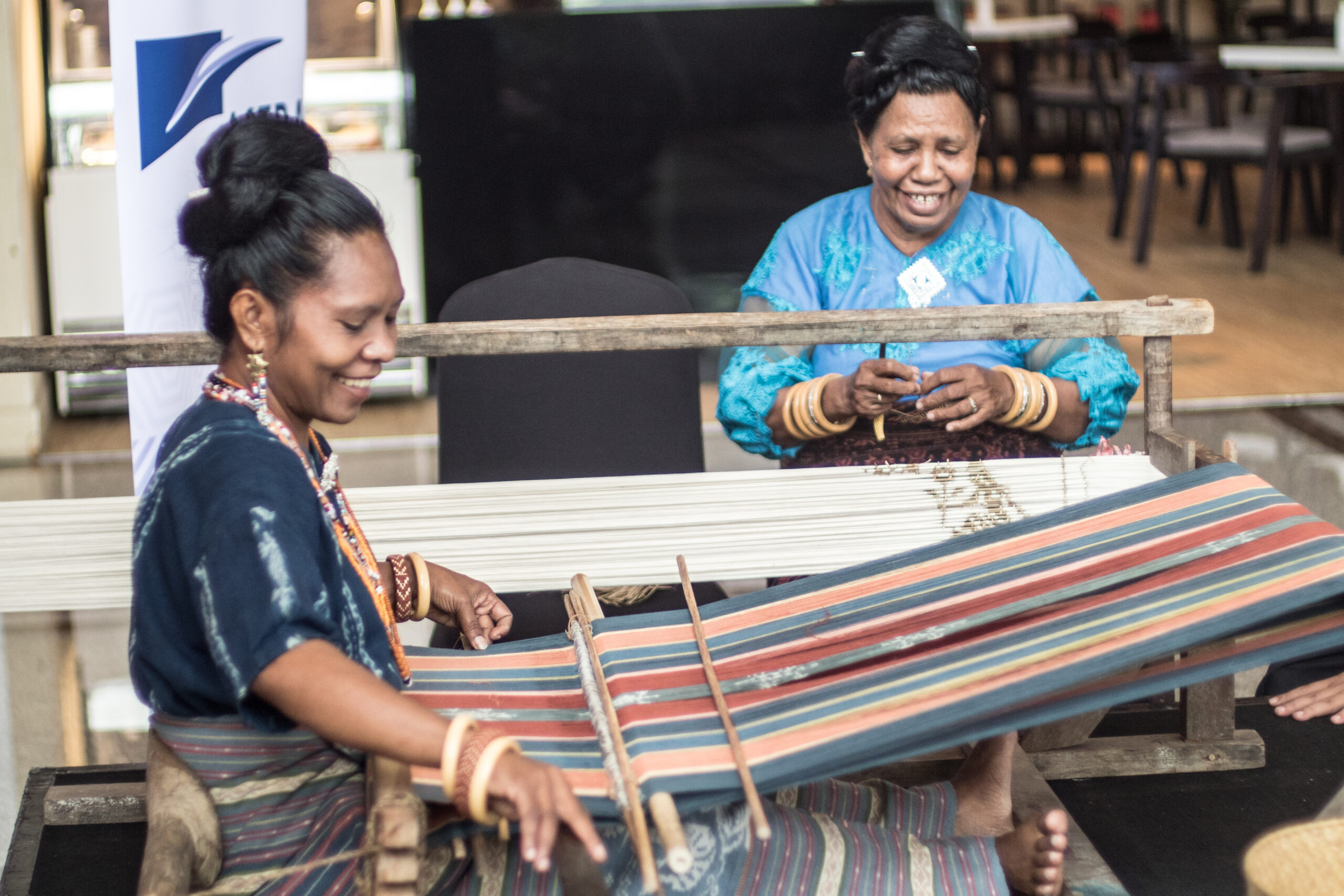 Women in Ikat Sikka Weaving process